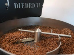 Frank Laurent Penang uses a Diedrich machine to roast international coffee beans