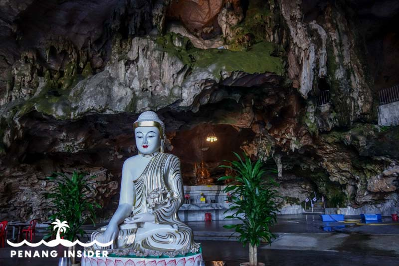 White seated Buddha inside Ipoh's Kek Lok Tong Cave Temple