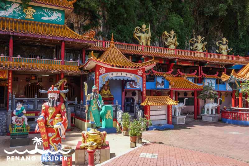 Cartoonish statues in the courtyard of Ipoh Cave Temple Ling Sen Tong