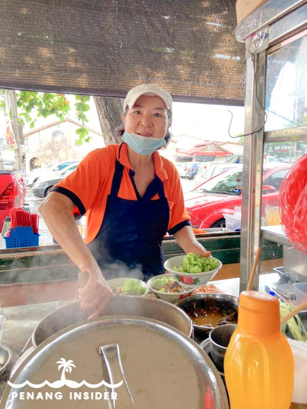 One of Kim Laksa's happy aunties serving some of Balik Pulau's most famous Penang Asam Laksa