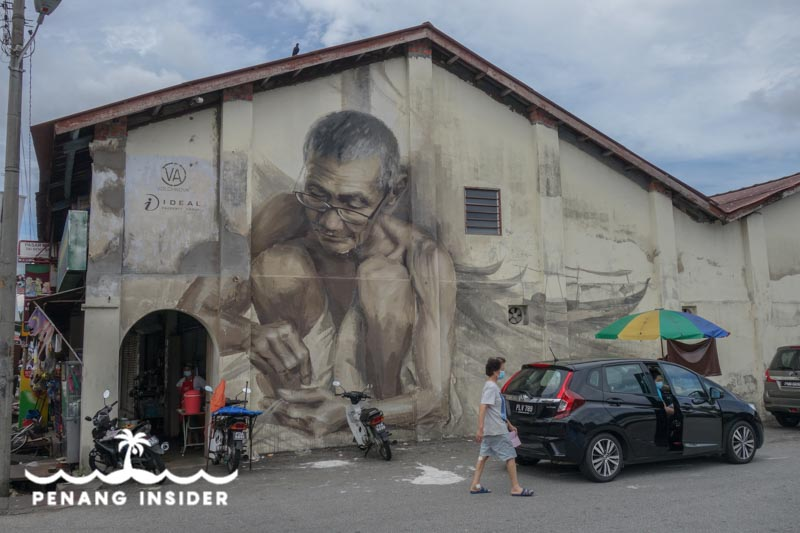 The Old Fisherman by Julia Volchkova spruces up the wall of a shophouse in the center of Balik Pulau