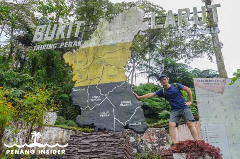 Marco Ferrarese stands next to Perak Bukit Larut sign in Taiping