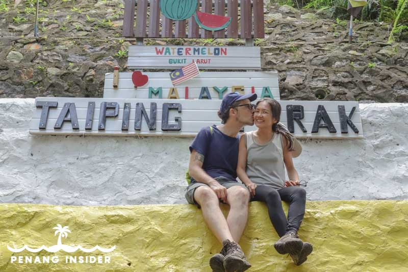 Marco Ferrarese kisses Kit Yeng Chan at the Watermelon station on Taiping's Bukit Larut hill station