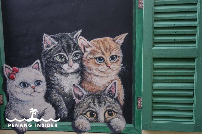 Penang Street Art four cats at the green window