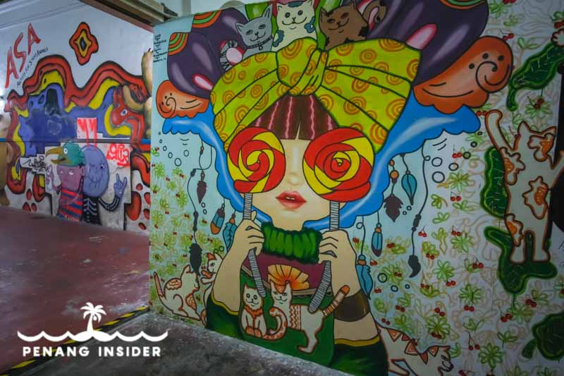 Colorful murals on the inside of Art Lane in George Town Penang