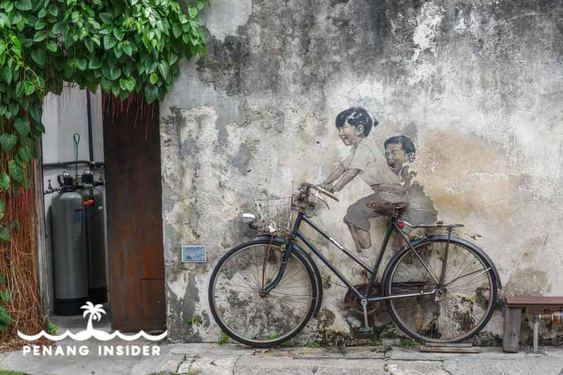 Little Children on a Bicycle by Ernest Zacharevic