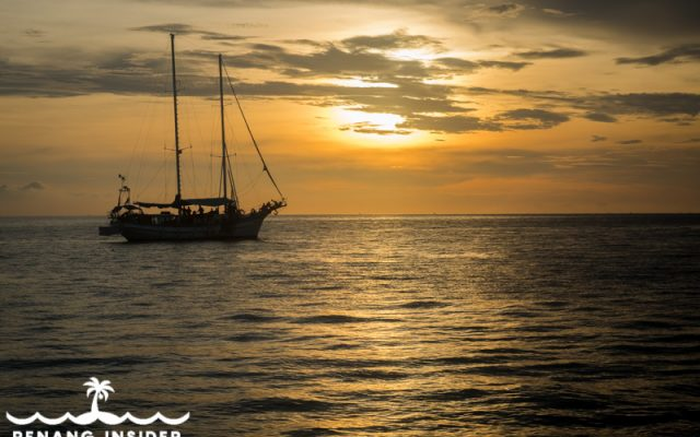 Yacht sailing against the sun in a Langkawi sunset cruise