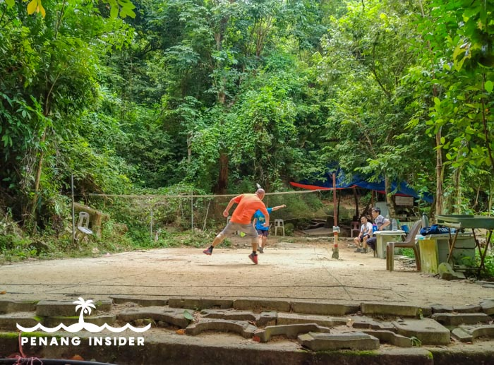 Locals play at the badminton court at the bottom of Bukit Hijau